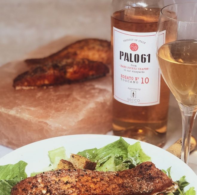 A bottle of Italian PALO61 wine paired with a delicious meal.